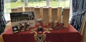 Presentation table with trophies and thank you gifts